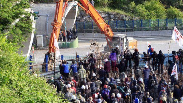 Demonstrators protesting against rail line