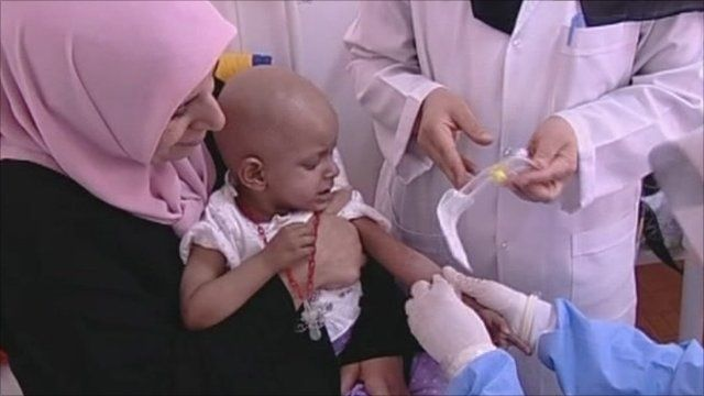 Child being given medical treatment in Benghazi hospital