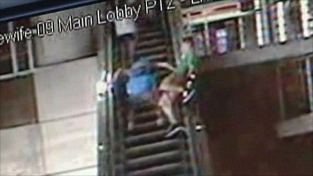 CCTV of teenager on an escalator