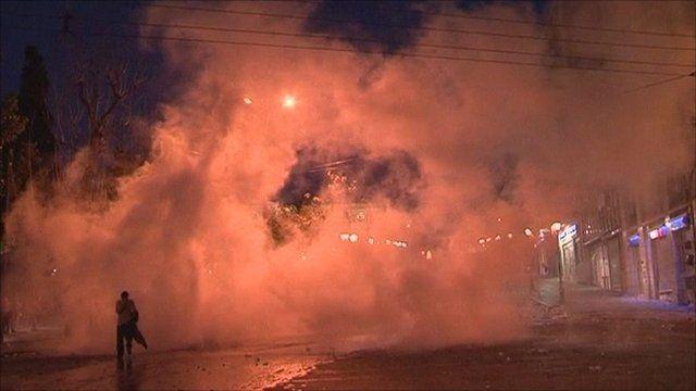 Man walking through smoke