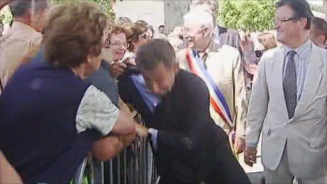 Sarkozy grabbed
