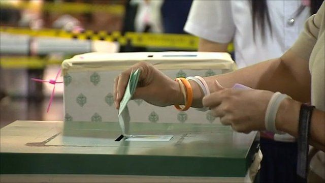 Woman casting vote in Thai election