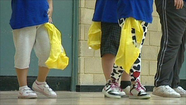 Children's legs, in sportswear