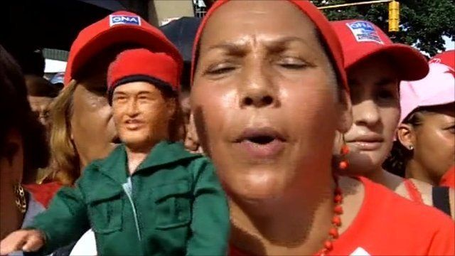 """Woman with """"Chavez"""" doll in Caracas"""