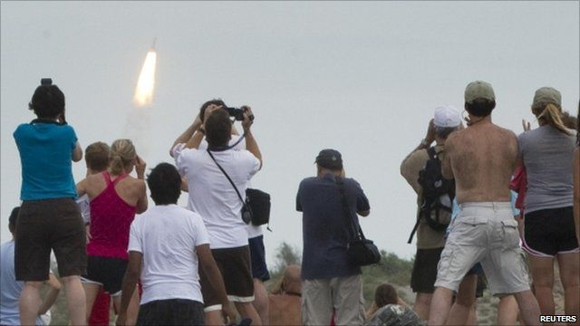 Spectators watch shuttle launch from Florida coast