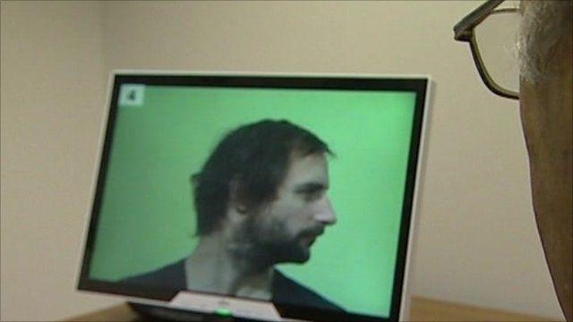Man looking at virtual ID parade