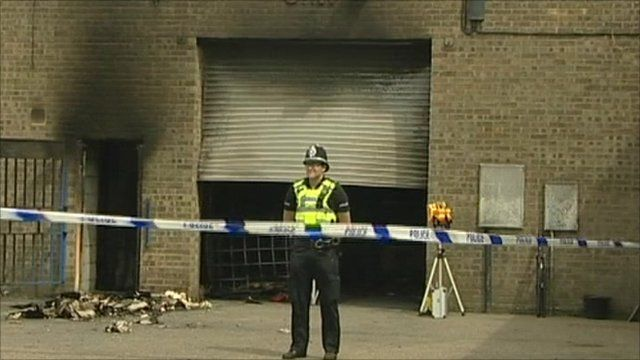 Police officer outside site of explosion