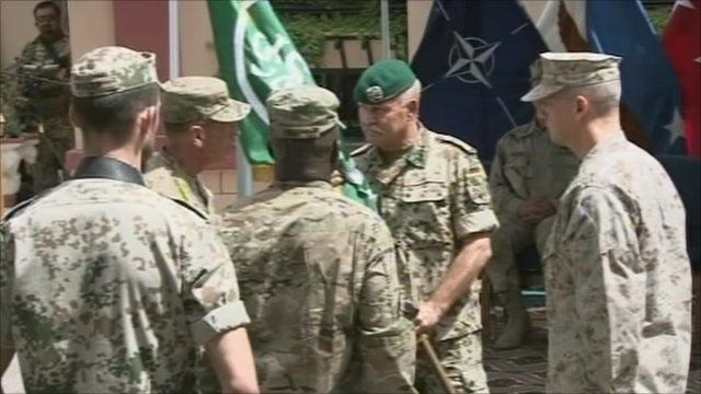 Gen David Petraeus hands flag over to Gen John Allen