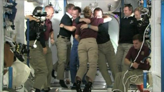 Atlantis crew say farewell to the crew of the ISS