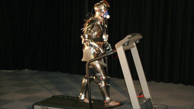 Man on a treadmill wearing medieval armour