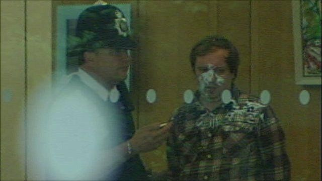 Police officer with man who attempted to attack Rupert Murdoch