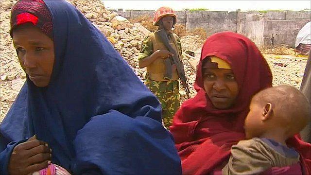 Women line up in an aid camp near Mogadishu