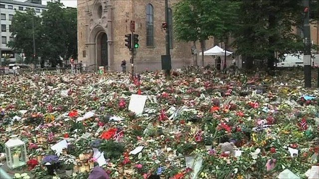 Flowers and candles commemorate the victims