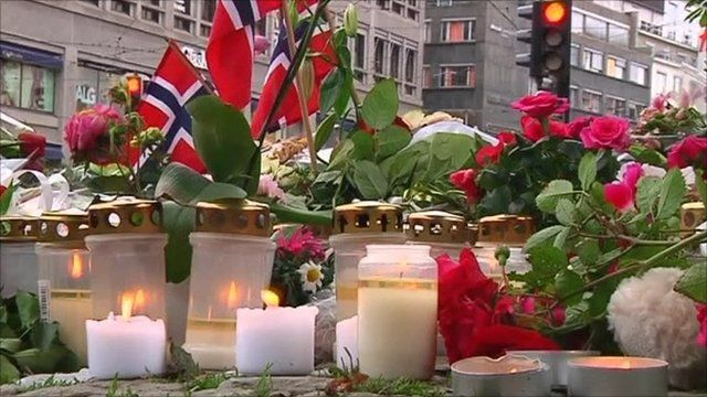 candles lit in Oslo to remember those killed in the terror attack