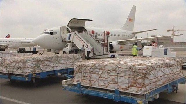 Aid supplies being loaded onto plane to assist in drought affected areas of Africa