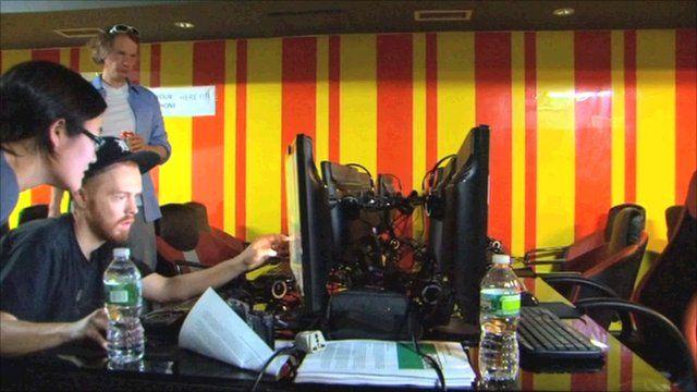 Evan Roth looking at a computer monitor
