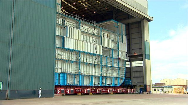 The hull of an aircraft carrier in BAE Systems shipyard