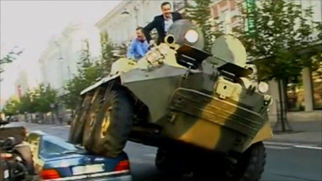 Mayor of Vilnius, Arturas Zuokas, crushes an illegally parked car