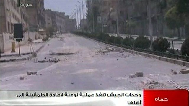 Syrian state TV images of a rubble-strewn street in Hama