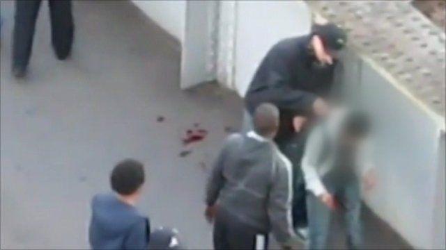 Injured man being mugged