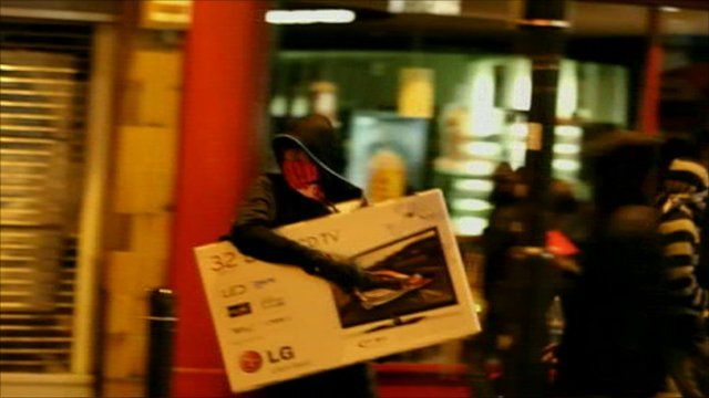 A looter makes off with a TV