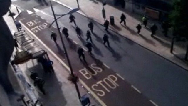 Police fending off a large group in Wolverhampton