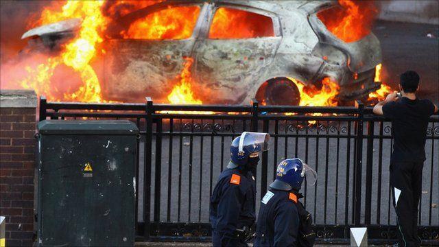 Police stand near burning car in Birmingham