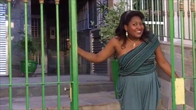 Leila Barbosa at the gate to her house