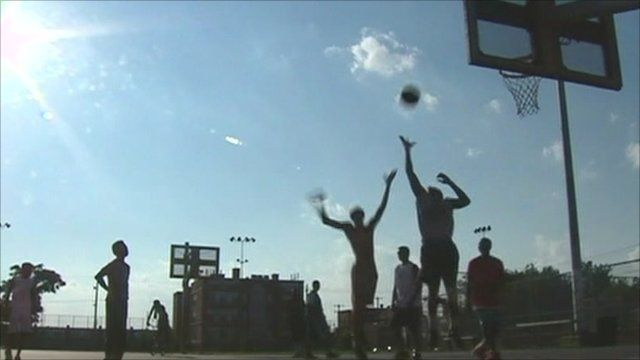Youths playing basketball at youth centre in Philadelphia