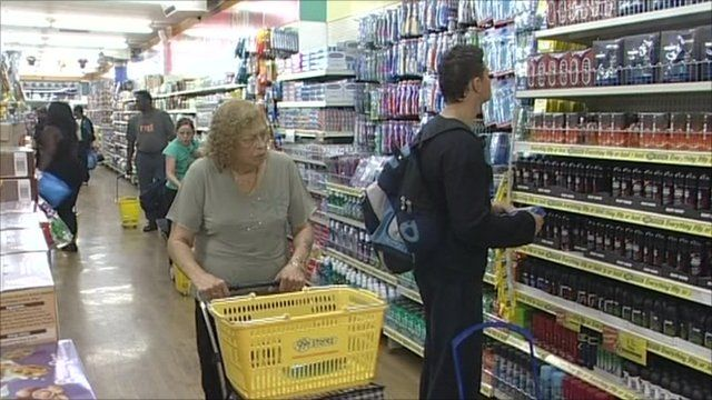 shoppers in a £1 store