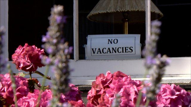 No vacancies sign in a window
