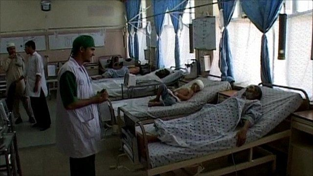 Doctor with survivors of a bus crash, in a hospital in Afghanistan
