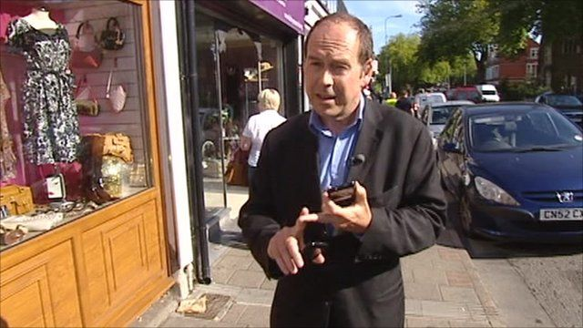 Rory Cellan-Jones holding mobile phones in Cardiff