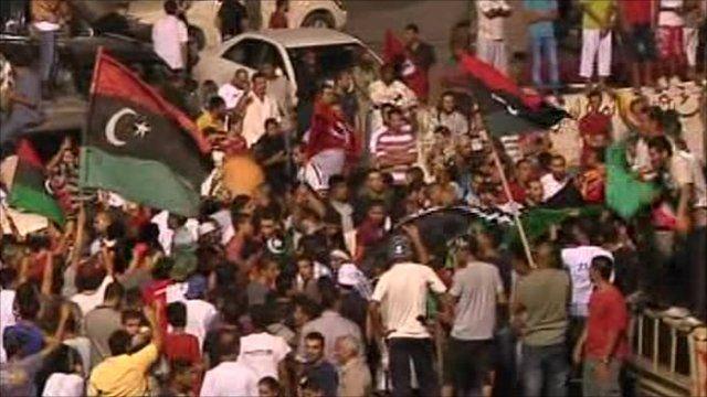 Rebels celebrate entering the Gaddafi compound