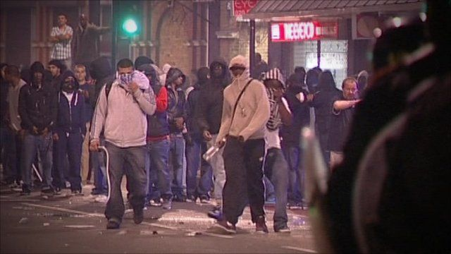 Rioters throwing missiles at police