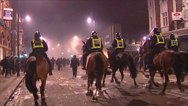 Mounted police heading towards rioters