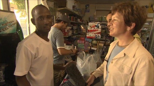 Lyse Doucet talking to a shopkeeper in Tripoli