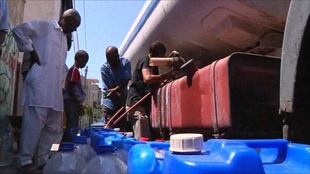 Collecting water in Tripoli