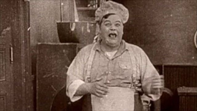 "Roscoe ""Fatty"" Arbuckle in silent film The Waiters' Ball"