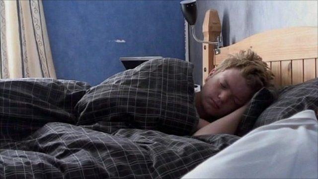 A teenager sleeping