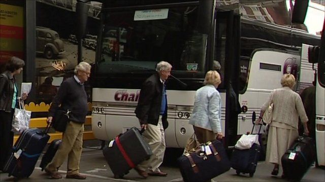 Older people getting on a coach