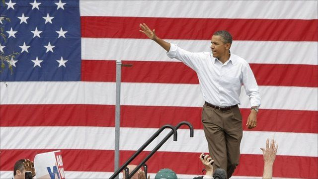 Obama on stage at a rally in Detroit