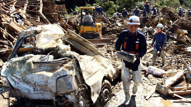 Fire crews sift through debris