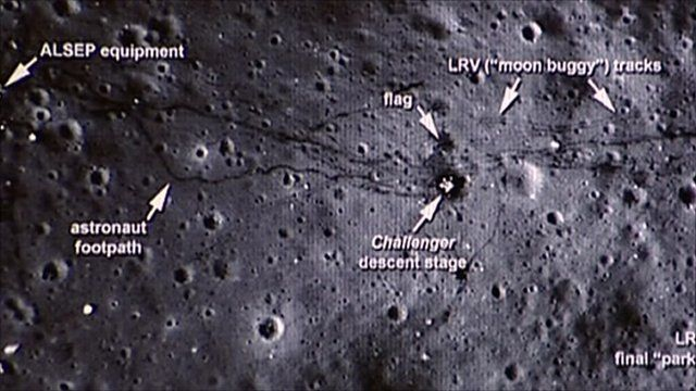 The images show the lunar rovers and a trail of footprints left by  astronauts