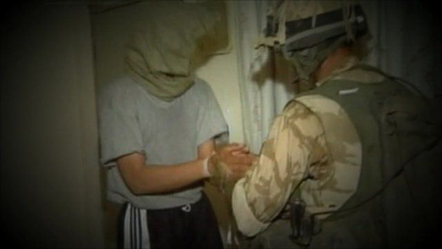 Detainee with soldier