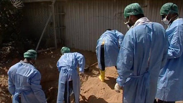 Forensic teams working at one of the roadside graves