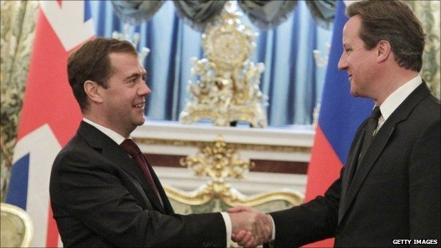 Russia's President Dmitry Medvedev (L) and British Prime Minister David Cameron (R)