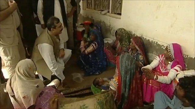 Pakistan's Prime Minister Yousuf Raza Gilani meets flood victims