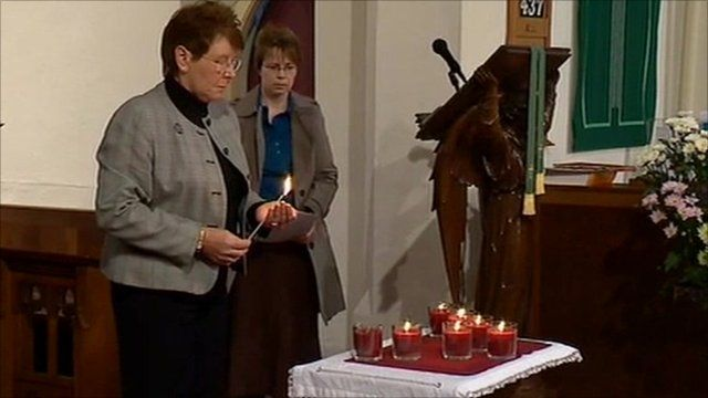 Candles lit at church service