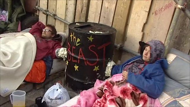 Dale Farm activists concrete themselves to barrel by main gate
